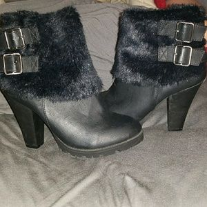 Black heeled ankle boots with fur accent